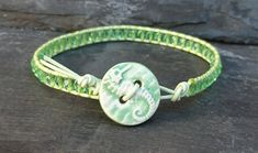 This delicate bracelet has been made with soft green leather cord and little glass beads. A decorative ceramic button with a pretty seahorse motif has been used as a fastener. It will fit a wrist size of If you'd like one made to fit you. Green Leather, Leather Cord, Wrap Bracelets, Beaded Bracelets, Ceramic Decor, Organza Gift Bags, Glass Beads, Buttons, Ceramics