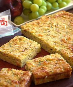 Zucchini Slice -Julie Goodwin The best zucchini slice recipe I've had and the kids love it too. Zuchinni Slice, Easy Zucchini Slice, Zucchini Tart, Gluten Free Zucchini Slice, Zucchini Squares, Zucchini Slice Thermomix, Vegetarian Zucchini Slice, Zucchini Quiche Recipes, Zuchini Quiche