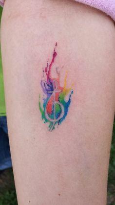 Watercolor treble clef cross tattoo by Hiren Patel of Avalon Tattoo & Piercing, 5633 Glenway Ave Cincinnati, Ohio (513) 347-0680. http://www.facebook.com/pages/Avalon-Tattoo-Piercing/335539706569?pnref=story