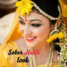 Her fresh smile has the fragrance of celebration ✨🌸🎊. Big red bindi, soothing kohl eyes, matte red on lips 👄 and floral ornaments 🌼 are the core of this minimal makeup art 🦋. She just amazed us with this sober Haldi Look 🌼. #shadesbeautysalon #bridalpackage #brides #haldi #floral #sangeet #celebrations #rituals #redbindi #kaajal #kohls #look #bridallook #instamakeup #instabeauty #instagood #instadaily #instalike #instabride #instagram