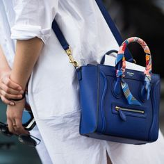 Hermes Twilly accenting the handle of a Celine bag. | Street Style - Details