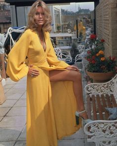 Suzanna Leigh in a yellow Ossie Clark 'Cuddly' wrap maxi dress.