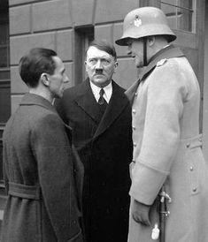 The towering figure of Defense Minister, General Werner von Blomberg, with Joseph Goebbels and Hitler in February 1934.