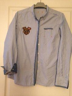 Chemise rayée bleu/blanc Napapijri A porter près du corps En très bon état Taille 40-42