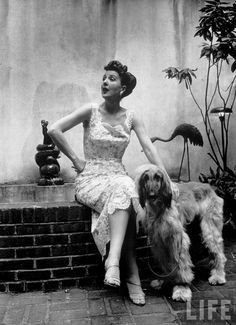 Alfred Eisenstaedt: Stripper Gypsy Rose Lee petting her Afghan dog as she relaxes at home. July 5, 1957