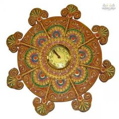 If you are looking for a utility-cum-decorative item that exudes class all the way, then bring home this wall clock . Made up of paper mache and the decoration on the wall clock is done by kundan work with different colors and artificial stones