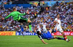 Gonzalo Higuain of Argentina and Manuel Neuer of Germany collide...