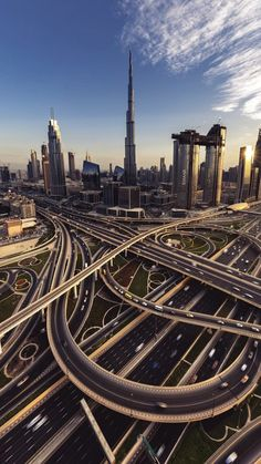 Downtown Dubai Sheikh Zayed Road interchange with Burj Khalifa in the background. I can't imagine driving this! Futuristic Architecture, Amazing Architecture, Building Architecture, Architecture Design, Places To Travel, Places To Visit, Dubai Holidays, Dubai City, Dubai Uae