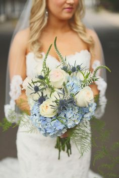 Love the pale blue hues in this bouquet of roses, veronica, hydrangeas, thistle and fern leaves. {@jwoodberyphoto}