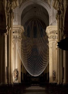 Designers Gijs Van Vaerenbergh have suspended a network of chains to create an upside-down dome inside this church in Leuven, Belgium.