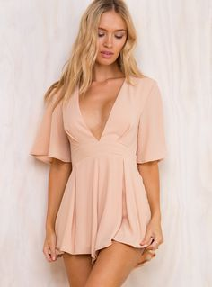 """A+Walk+In+Rome+Playsuit+-+ Sheer+crepe+playsuit! Low+cut+v+neckline Ties+up+at+waist Oversized+sleeves Invisible+zip+at+back Polyester Length+of+size+8+shoulder+to+hem:+80cm Roxy+is+wearing+a+size+8 Roxy's+deets Dress+size+8 Height:+173cm+(5'8"""") Bust:+86cm Waist:+65cm Hips:+91cm"""