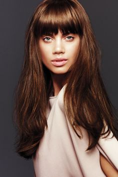 Maybe this color... bit lighter but still boarderline chocolate.. milk chocolate hair?  Not into the fringe