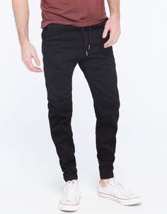 Charles and a Half twill jogger pants. Slant front pockets with welt back pockets. Elastic drawstring waist. Elastic at leg openings. 97% cotton/3% spandex. Machine wash. Imported.