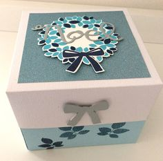 Paper gift box, size 4-1/2 by 4-1/2.