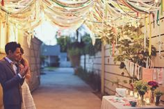 so so so sweet. I think those are little strips of fabric. Draped Fabric, Fabric Garland, Fabric Canopy, Ribbon Garland, Fabric Awning, Ribbon Backdrop, Hanging Fabric, Ribbon Banner, Bunting Garland