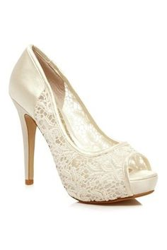White vintage Heels.  I would definitely wear this when I get married.