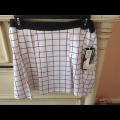 NWT Tennis Skirt Pure Lime Size L Plaid White Red and Black.  NWT.  Does not have a shorts underneath.  Pleated with elastic waist band.  Purchased from the tennis club pro shop. Pure Lime Skirts