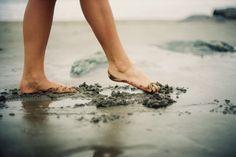 Walking barefoot through the sand