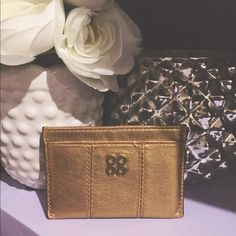 S A L E  C o a c h   C a r d   C a s e Gold Authentic Coach Card Holder. In excellent condition. Used for going out for a small clutch or crossbody. Coach Bags Wallets