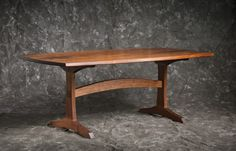 I love just about everything about this one.  Great color.  Great curve on the stretcher and along all sides.  Simple but elegant feet.  Book matched, two piece top that has mirrored grain.  Likely scalable to make a shorter table yet maintain proportions.  It may have a slight bevel along the edge.  I would experiment with a bevel on either the top or bottom side of the edges.
