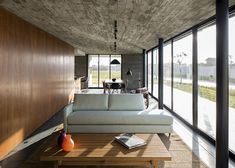 Wood and concrete can be warm with enough light.  MAPA's XAN House in Brazil combines raw concrete with slatted timber