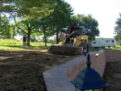 Grading top of retaining wall.