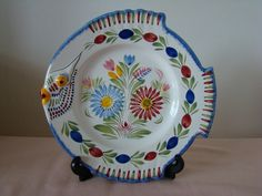 Beautiful vintage HB Henriot Quimper hand painted and signed fish shaped plate/plaque 9-1/2 diameter. No chips, cracks or crazing. Floral design mostly pink, blue, green and yellow on a white background. Excellent condition.  Will be well packaged, in order to keep postage costs down I use recycled boxes.  Thank you for looking.