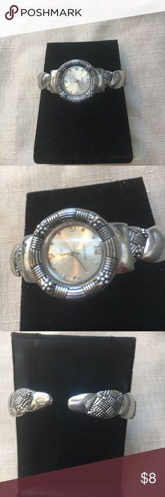 Silver tone bracelet watch. Nicely detailed silver tone bracelet watch; only worn a few times – excellent condition. Jewelry Bracelets