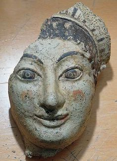 Antefix in the shape of a female head,  Architectural element; End of the 6th century BC; Terracotta | Musei Capitolini, Roma