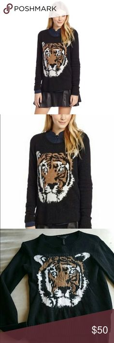 BCBGMAXAZRIA Wanda Intarsia Tiger Sweater black Sm This is a really great slightly oversized sweater from BCBGMAXAZRIA. It is the Wanda intarsia sweater with beautiful tiger face design. Black knit, size small. New! BCBGMaxAzria Sweaters Crew & Scoop Necks