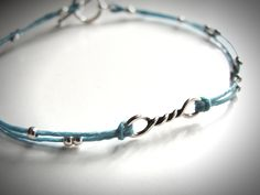 Twisted in Blue Sterling and Linen bracelet. $22 from JewelryByMaeBee on Etsy.