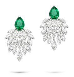 Extremely Piaget earrings in white gold set with marquise-cut diamonds and pear-shaped emeralds (=)