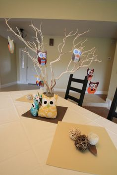 Larger tree idea, could hold a game like guests bring a hair ornament, and mom-to-be picks her favorite.  Winner get prize!  Could do onesies, socks...
