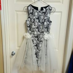 Formal bridal dress Black short dress with white sequins and tool skirting that is detachable. Andrew Adele Dresses Wedding