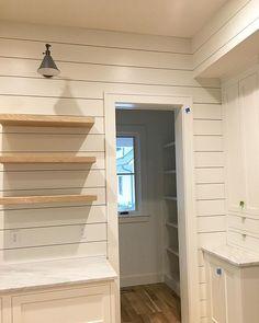 Kitchen corner peaking into the pantry. #modernfarmhouse #shiplap #design #kitchen #kitchendesign #whitekitchen #marble