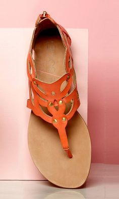 Laser cut gladiator sandal in coral with a thong silhouette and an easy back zipper