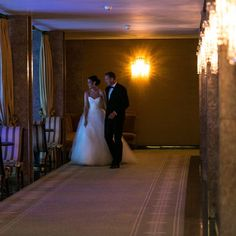 The newly weds sneak away to the Ballroom's foyer.