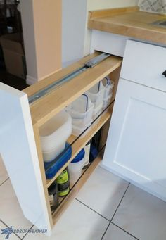 hidden kitchen storage turn a filler panel into a pull out cabinet, kitchen cabinets, kitchen design, organizing, storage ideas, woodworking projects, All stocked up and ready to use