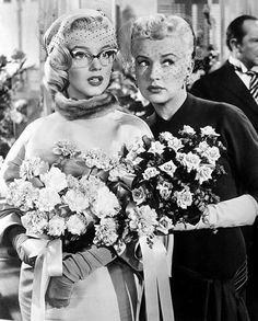 "Marilyn Monroe as Pola Debevoise and Betty Grable as Loco Dempsey in ""How to Marry a Millionaire"" 1953"