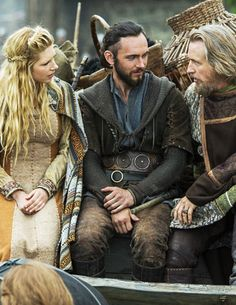 Lagertha, Athelstan and King Ecbert - Katheryn Winnick, George Blagden and Linus Roache in Vikings, set in the 9th century (TV series).