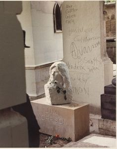 I took this at the grave of Jim Morrison, Pere Lachaise Cemetery, Paris, France, June 1981. Just weeks before the 10th annviersary of his death on July 3,1971. This is the original headstone that was eventually stolen. You can see the outline of one of the two policeman standing guard.