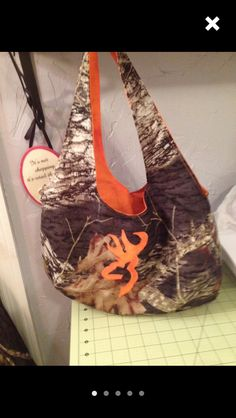 Realtree Browning handbag. Available on Realtree with orange, hot pink or blue. For more information email me at info@cuddlybunny.com