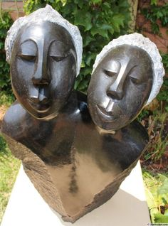 Sisters ii - a sculpture in Springstone by Agnes Nyanhongo.