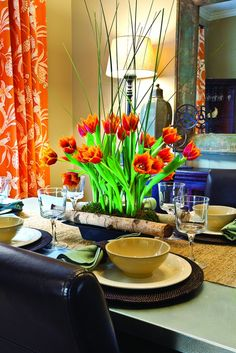 Use colorful flowers to compliment your home's brightest accents. #floralarrangement #decoratingwithorange