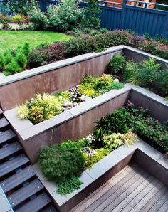 Sunken stepped terraces at the back of the yard. A great solution if you want to keep a vegetable garden out of sight.