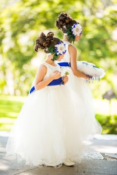 We <3 their hairdo, hairpiece, and adorable dress. Royal Blue + White wedding | Beautiful Day Photography