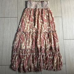 """Tiered skirt *note to buyer*Super cute tiered paisley print skirt. This is not one of those cheapie skirts if you know what I mean the fabric is supersoft. Many colors there is cream and a burgundy red some brown and little hints of a blackish gray. This skirt doesn't seem to have a tag but I think it would** fit a small but I'm a medium person and it fits me perfect.**I showed in the picture the skirt is 12"""" at no stretch and 17 at Max stretch. Skirts A-Line or Full"""