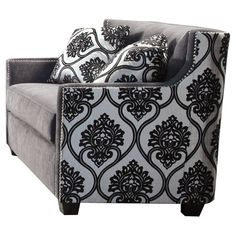 An eye-catching addition to your living room or parlor, this stylish loveseat features damask-print upholstery and sleek nailhead trim.