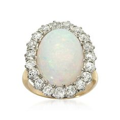 vintage opal and diamond ring. OMG i saw a ring identical to this in an antique store just the other day! favorite