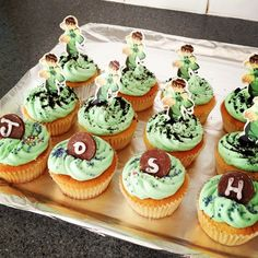 Ben 10 Cupcakes... a plain vanilla cake with a green vanilla frosting. Decorations are name spelled on chocolate discs with party sprinkles...   and white chocolate & rice paper Ben 10 figures, with Oreo cookie crumbs sprinkled.